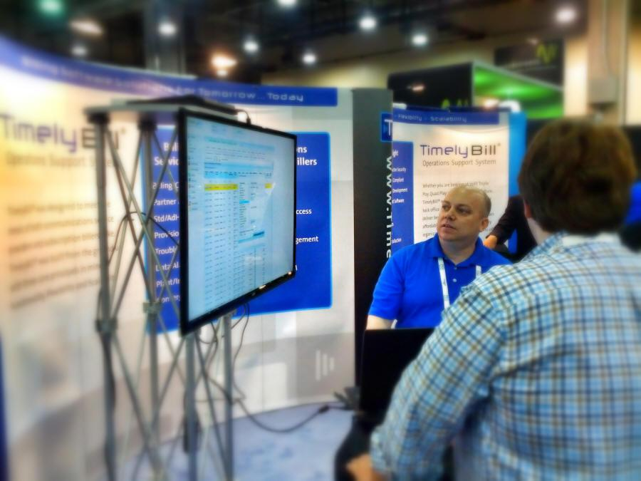 Michael Lates, demos TimelyBill on the floor at Comptel PLUS in Dallas